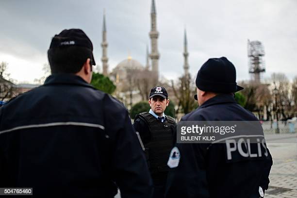 TOPSHOT Turkish police officers stand guard near the Blue Mosque in Istanbul's tourist hub of Sultanahmet on January 13 a day after an attack Turkish...