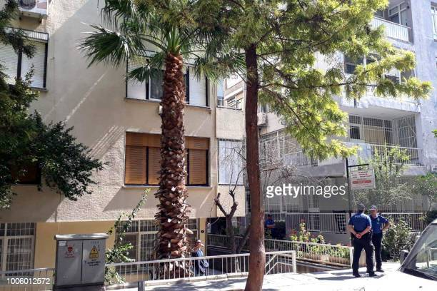 Turkish police officers stand guard next to an apartment of US Pastor Andrew Brunson on July 27 2018 in Izmir Brunson was moved from jail to house...