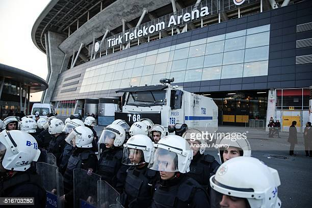 Turkish police officers stand guard outside the Turk Telekafter the Turkish Spor Toto Super Lig match between Galatasaray and Fenerbahce was...