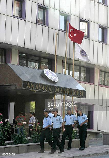 Turkish police patrol in front of the Constitutional Court in Ankara on July 28 2008 The Constitutional Court convened today to decide whether to...