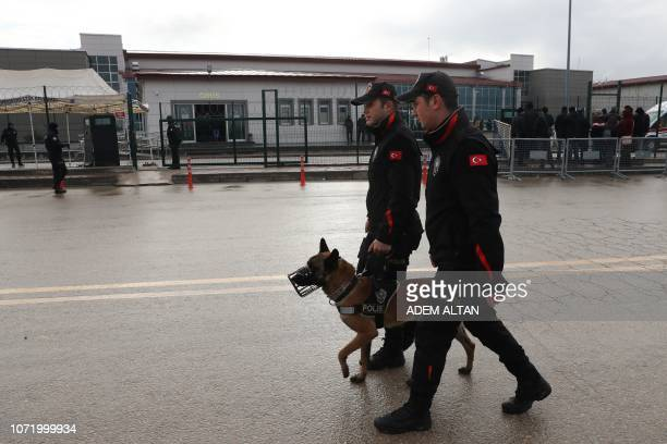 Turkish police patrol in front of the courthouse in Ankara during the hearing of the proKurdish party Peoples' Democratic Party former coleader...