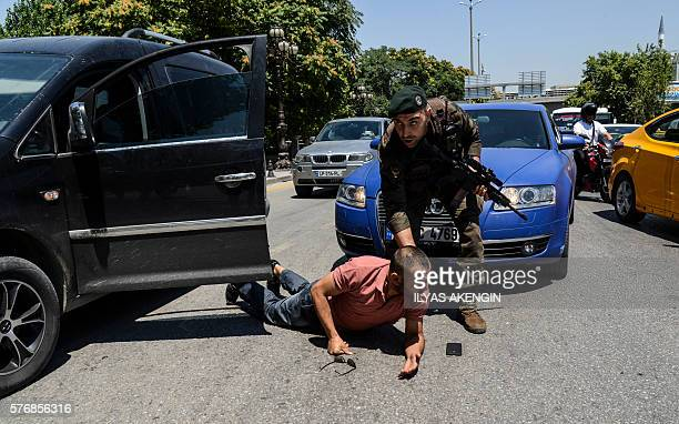 Turkish police restrains a man on the ground during an operation in front of the courthouse on July 18 in Ankara Turkey has detained more than 7500...