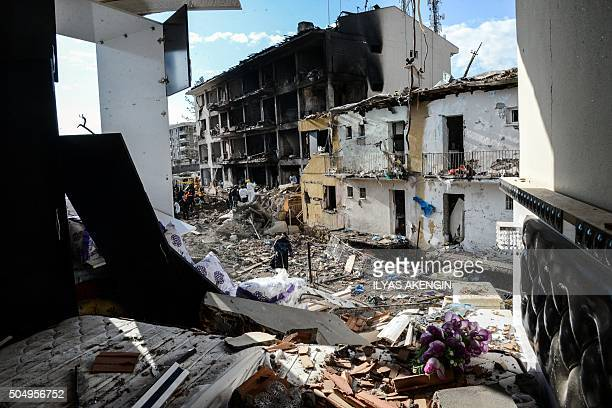 TOPSHOT Turkish police search through the wreckage of a blast damaged building on January 14 2016 in Diyarbakir Six people died and 39 others were...