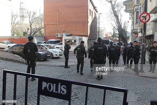 Turkish police secure the blast scene after an explosion in the central Istanbul Sultanahmet district on January 12 2016 in Istanbul Turkey At least...