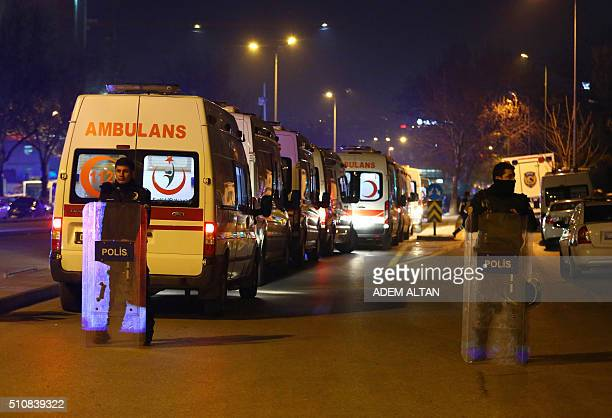 Turkish police secure the site of an explosion after an attack targeted a convoy of military service vehicles in Ankara on February 17 2016 At least...