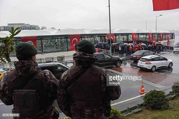 Turkish police special forces officers guard at the scene of Saturday's blasts on December 12 2016 in Istanbul Turkey At least 44 people were killed...