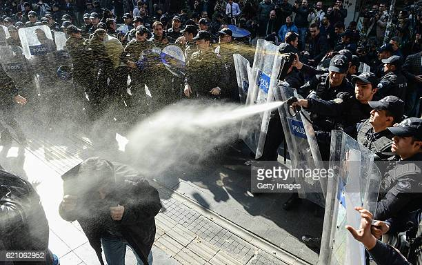 Turkish police spray papper gas as they arrest protestors during a anti-government protest on November 4, 2016 in Ankara, Turkey. Co-leaders of the...