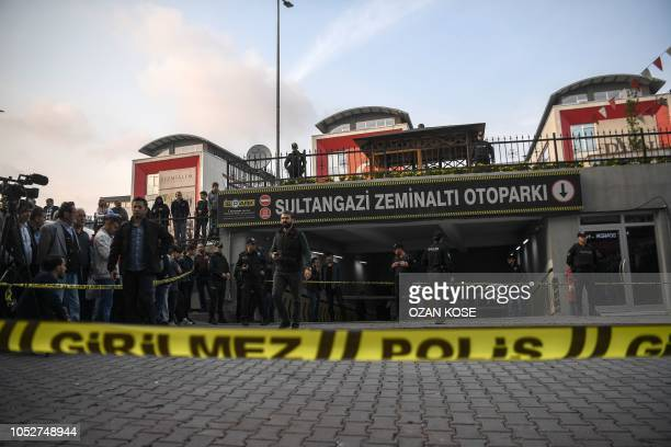 Turkish police stand guard as they cordoned off an underground car park, on October 22, 2018 in Istanbul, after they found an abandoned car belonging...