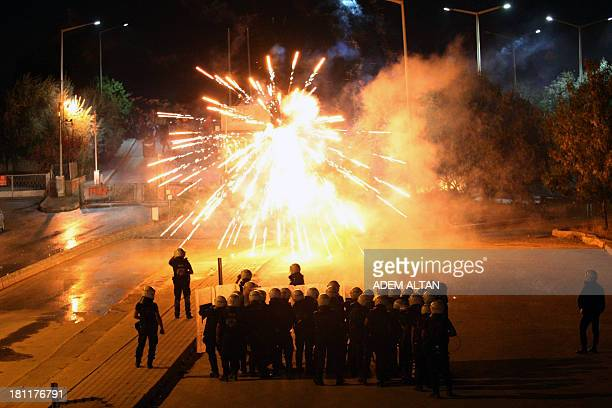 Turkish police stand in front of fireworks thrown by demonstrators during a protest on September 19, 2013 outside the Middle East Technical...