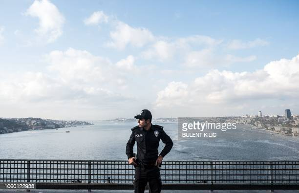 A Turkish police stands guard on the July 15 Martyrs' Bridge known as the Bosphorus Bridge during the 40th annual Istanbul Marathon on November 11 in...