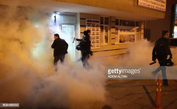Turkish police use teargas against members of the Halklarin Demokratik Partisi during a protest against Turkeys 'Olive Branch' operation in Syria on...