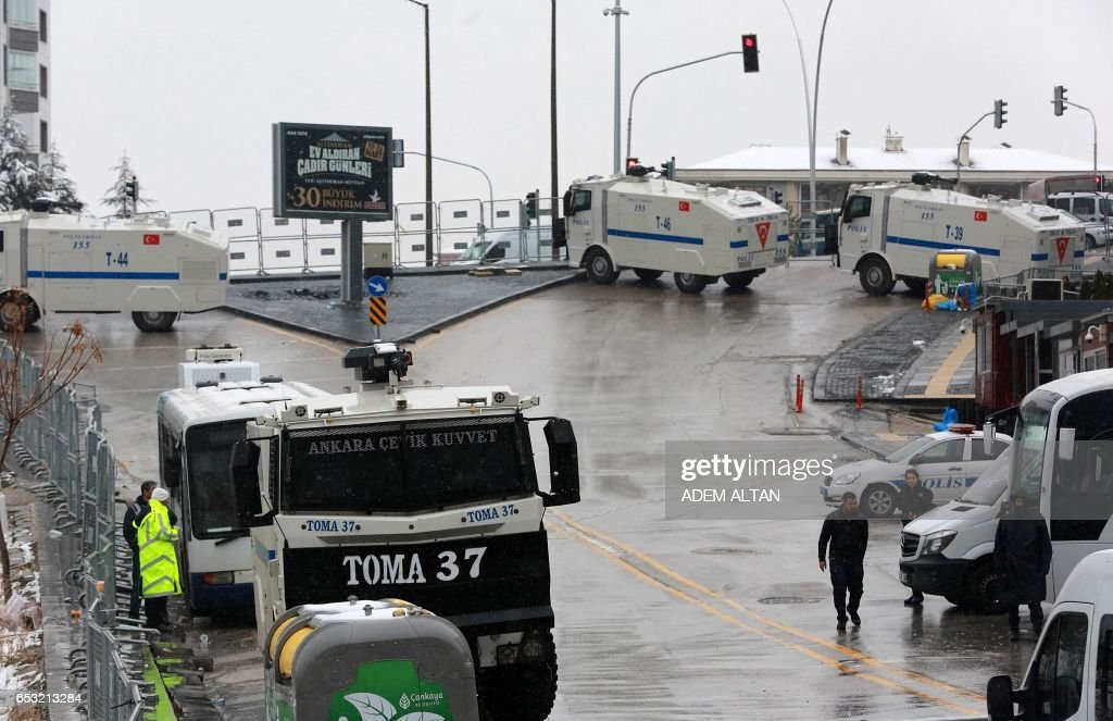 Turkish police vehicles are parked in front of the Dutch embassy in Ankara on March 14, 2017. Tensions between Turkey and EU member states increased after Germany and the Netherlands banned events where Turkish politicians wanted to rally support ahead of a vote next month. The Dutch also expelled the Turkish family minister at the weekend. /