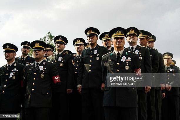Turkish policemen attend the funeral ceremony of special forces police officer Meric Alemdar killed during the failed July 15 coup at the Kocatepe...