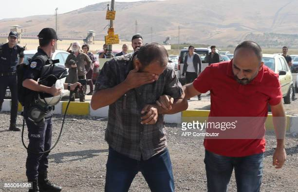 Turkish policemen spray pepper gas at protesters during a court hearing of academic Nuriye Gulmen and teacher Semih Ozakca outside the Sincan prison...