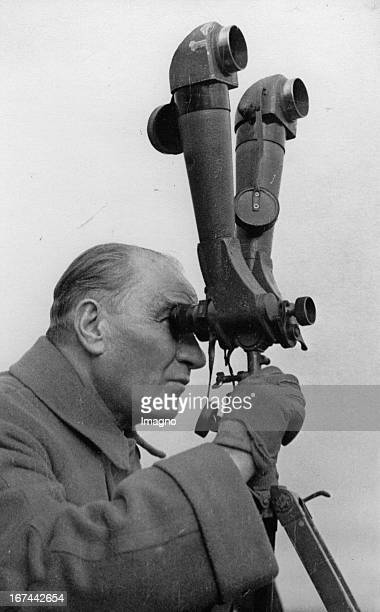Turkish politician and the first President of the Republic of Turkey Mustafa Kemal Ataturk looking through a telescope About 1935 Photograph Der...