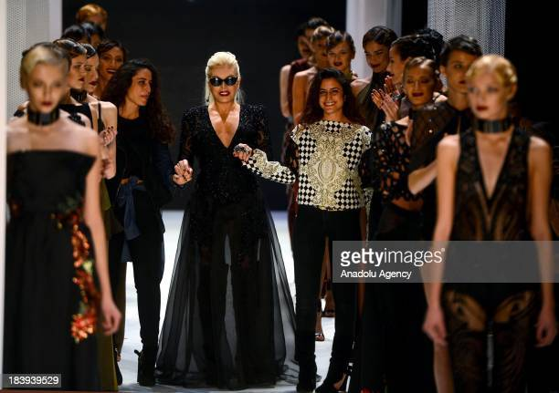 Turkish popstar and singer Ajda Pekkan attends MercedesBenz Fashion week as the models display a creation by Raisa Sason and Vanessa Sason on the 4th...