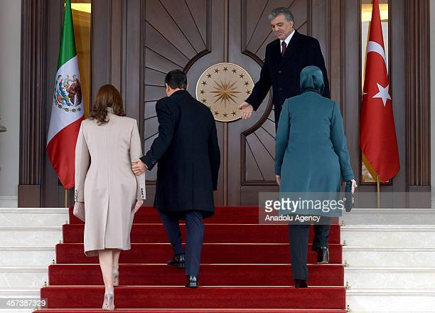 Turkish President Abdullah Gul and his spouse Hayrunnisa Gul welcome Mexican President Enrique Pena Nieto and his spouse Angelica River during a...