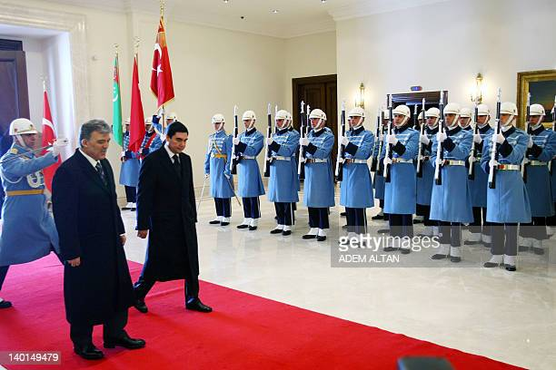 Turkish President Abdullah Gul and his Turkmen counterpart Gurbanguly Berdymukhamedov review an honor guard on February 29, 2012 during an official...