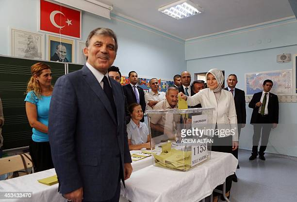 Turkish President Abdullah Gul and his wife Hayrunissa Gul vote for Turkey's presidential election at a polling station in Ankara on August 10 2014...