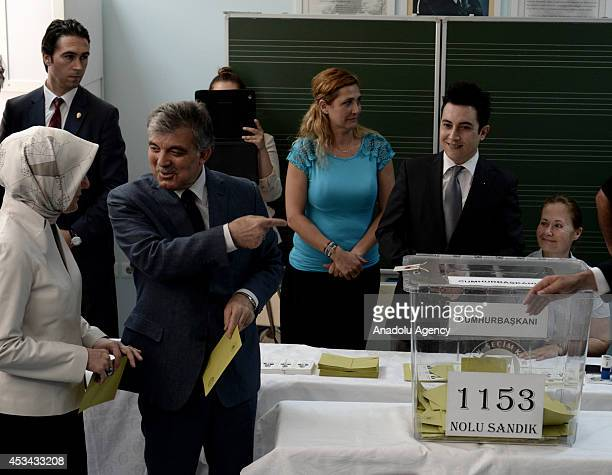 Turkish President Abdullah Gul and his wife Hayrunnisa Gul cast their ballots in the Turkey's presidential election at a polling station in Ankara...