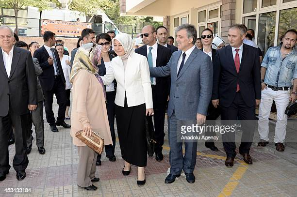 Turkish President Abdullah Gul and his wife Hayrunnisa Gul leave a polling station after casting their ballots in the Turkey's presidential election...