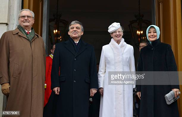 Turkish President Abdullah Gul and his wife Hayrunnisa Gul pose with Queen Margrethe II of Denmark and her husband Prince Henrik at the door of...