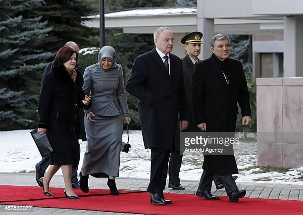 Turkish President Abdullah Gul and his wife Hayrunnisa Gul welcome Moldova's President Nicolae Timofti , and his wife Margareta Timofti during an...