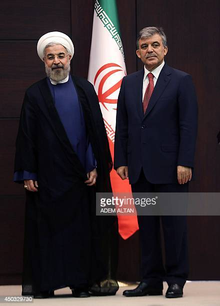Turkish President Abdullah Gul and Iranian President Hassan Rouhani give a press conference at the presidential palace in Ankara on June 9 2014...
