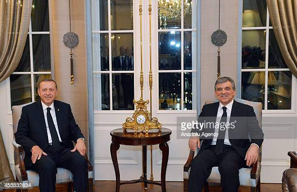 Turkish President Abdullah Gul and Turkish Presidency election winner Recep Tayyip Erdogan pose during a 1-hour meeting following the farewell...