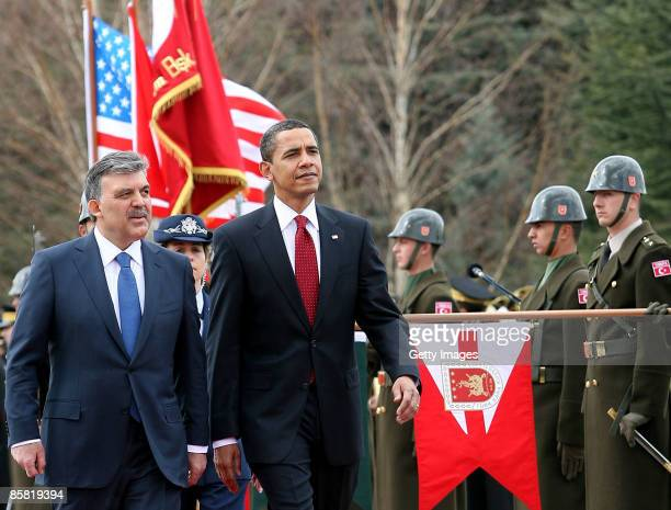 Turkish President Abdullah Gul and U.S. President Barack Obama attend a welcoming ceremony in the courtyard of the Cankaya Presidential Palace on...