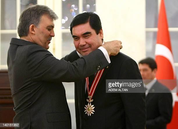 Turkish President Abdullah Gul awards his Turkmen counterpart Gurbanguly Berdymukhamedov with one of Turkey's highest state orders on February 29,...