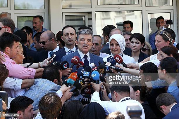 Turkish President Abdullah Gul flanked by his wife Hayrunnisa gives a press point after voting for Turkey's presidential election at a polling...