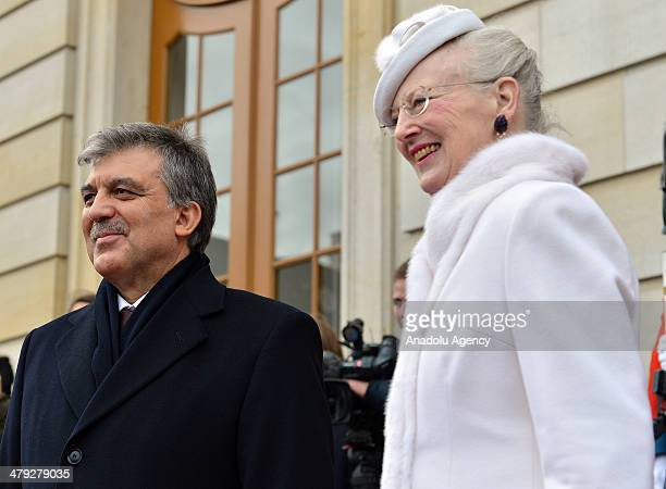 Turkish President Abdullah Gul is welcomed by Queen Margrethe II of Denmark at Amalienborg Palace with cavalier unit in Copenhagen Denmark on March...