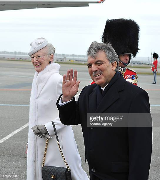 Turkish President Abdullah Gul is welcomed by Queen Margrethe II of Denmark with military ceremony at Amalienborg Palace in Copenhagen Denmark on...