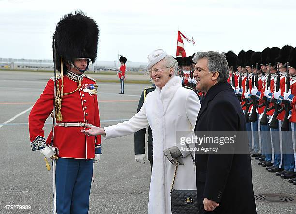 Turkish President Abdullah Gul is welcomed by Queen Margrethe II of Denmark with a military ceremony at Amalienborg Palace in Copenhagen Denmark on...