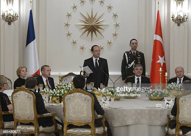 Turkish President Abdullah Gul listens as President of France during the dinner at Cankaya Presidential Palace in Ankara Turkey January 27 2014