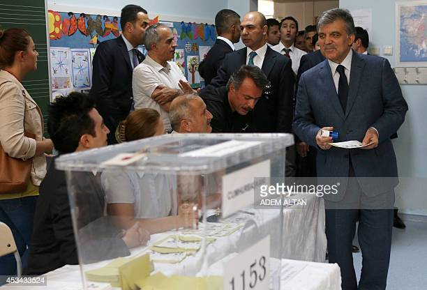 Turkish President Abdullah Gul prepares to vote for Turkey's presidential election at a polling station in Ankara on August 10 2014 Prime Minister...