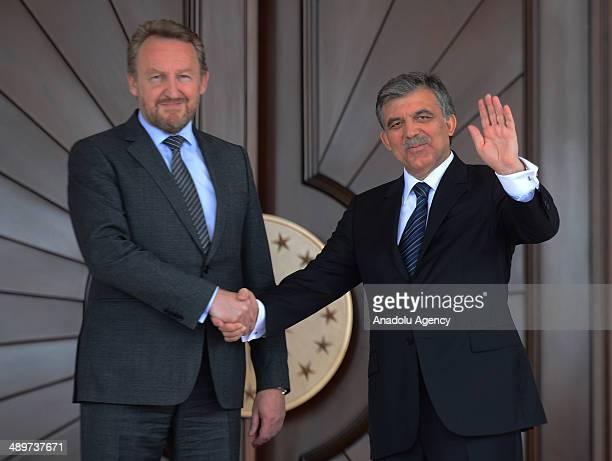 Turkish President Abdullah Gul shakes hand Bakir Izzetbegovic the Bosniak member of the threemembered presidency council of Bosnia and Herzegovina...