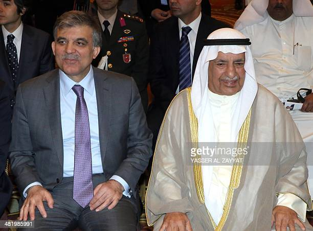 Turkish President Abdullah Gul sits next to Kuwaiti's Chamber of Industry and Commerce chairman Ali alGhanem during the KuwaitiTurkish economic forum...