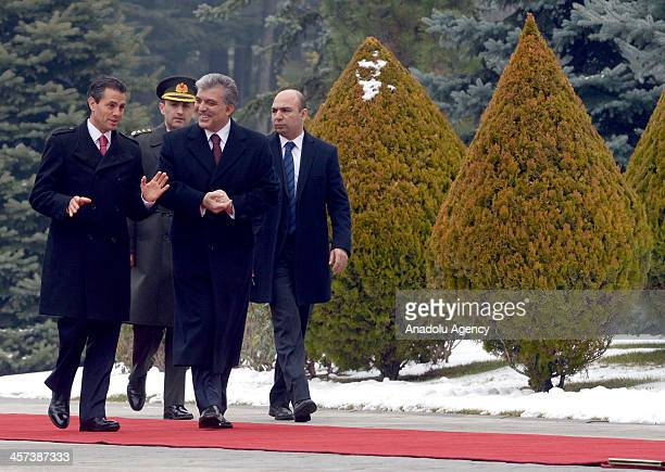 Turkish President Abdullah Gul walks with his Mexican counterpart Enrique Pena Nieto during a welcoming ceremony at the Cankaya Palace on December...