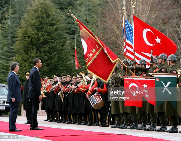 Turkish President Abdullah Gul watches as U.S. President Barack Obama greets the honour guard during a welcoming ceremony in the courtyard of the...