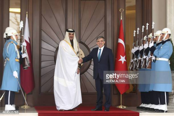 Turkish President Abdullah Gul welcomes Qatar's Emir Sheikh Tamim bin Hamad alThani before a meeting in Ankara Turkey on February 14 2014 AFP PHOTO /...