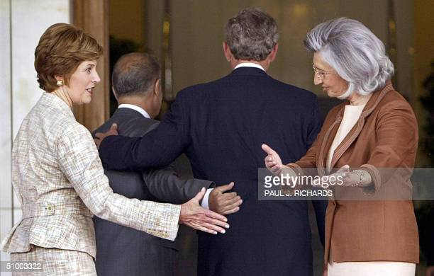 Turkish President Ahmet Necdet Sezer and US President George W. Bush walk together as US First Lady Laura Bush and her Turkish counterpart Semra...