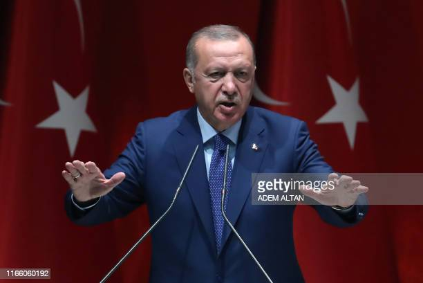Turkish President and leader of Justice and Development Party Recep Tayyip Erdogan delivers a speech during AK Party's extended meeting of Provincial...