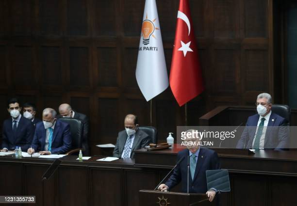Turkish President and leader of the Justice and Development Party Recep Tayyip Erdogan delivers a speech during a meeting of members of the AK Party...