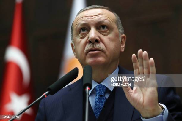 Turkish President and leader of the Justice and Development Party Recep Tayyip Erdogan gestures as he delivers a speech during the AK Party's...