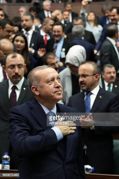 Turkish President and leader of the Justice and Development Party Recep Tayyip Erdogan acknowledges the audience during the AK Party's parliamentary...