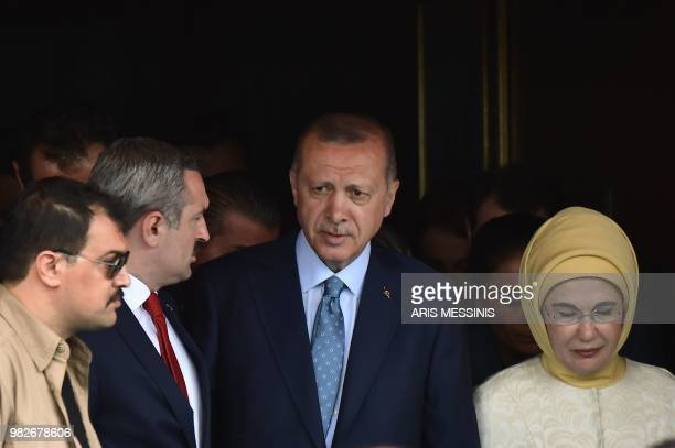 TOPSHOT Turkish President and leader of the Justice and Development Party Recep Tayyip Erdogan and his wife Emine Erdogan leave after casting their...