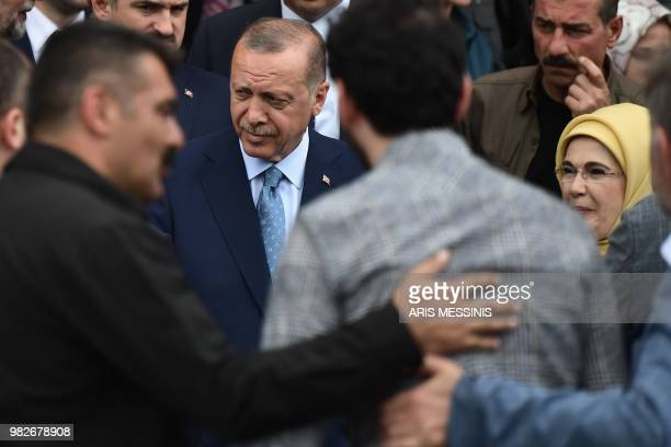Turkish President and leader of the Justice and Development Party Recep Tayyip Erdogan and his wife Emine Erdogan leave after casting their ballots...