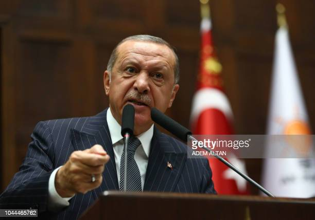TOPSHOT Turkish President and leader of Turkey's ruling Justice and Development Party Recep Tayyip Erdogan addresses the crowd during his party's...